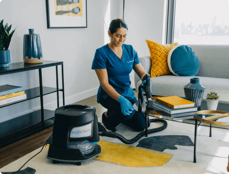 maid cleaning living room